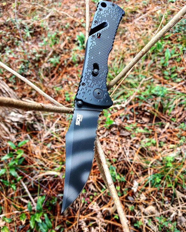 SOG TF3-CP. Has a black Tini coated AUS 8 stainless steel blade with a beautiful striped pattern that releases easily with an Arc-lock technology. #sog #tini #coated #partially #serrated #TF3-CP