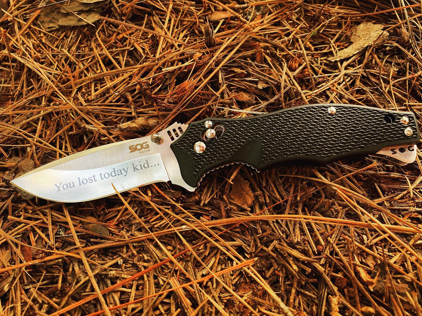 SOG Vulcan VL-01 knife.  This was just engraved -You lost today kid! But keep trying and you can be a winner! #vulcan #vulcanknives #VL-01 #engravedknives